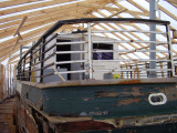 Aft deck with cabin.  I get a kick out of the building placed around the boat.