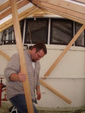 Micah makes a slight and important adjustment to one of the building's structural support beams.