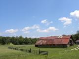 Blue Sky, Green Grass, Red Roof