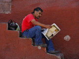 Reading Newspaper San Miguel Steps