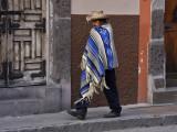Poncho Man Walking Street