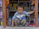 Boy in Store Window