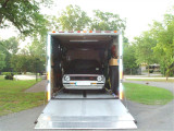 SOME OF YOU WANTED TO SEE THE UPGRADED DOOR/RAMP ON MY TRAILER ALSO YOU CAN SEE BOTH THE TRAILER AND 'BIRD SPARE TIRES