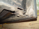 THE BOTTOM OF THE DOOR FRAME IS ATTACHED TO THE GENSET DRAWER USING BOLTS AND NUTS THROUGH THIS BRACKET AND SPACERS