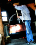 A skilled cheese-maker, wood fire and some special tools...