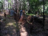 Wrought Iron fences around most graves