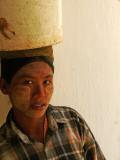 Woman with bucket Shwezigon.jpg