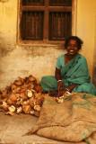 Woman with coconut peels Madurai.jpg