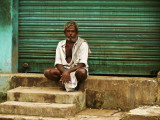 Man against green shutter Kumbakonam.jpg