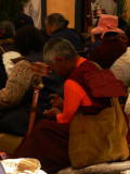 Leaning on prayer wheel