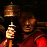 Holding prayer wheel