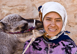 A young woman and a Dromedary baby