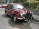 With an Ambassador, a popular car.