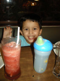All smiles for watermelon juice.