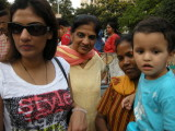 Watching a performing monkey at a street fair with Archana, Nani, and Anna
