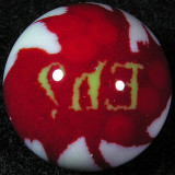 Ha, do you get it? Chris built a murrine cane w/ the Canadian maple leaf, then a sphere grinder turned that cane into a marble.