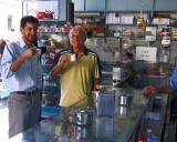 Cesar and Pedro take coffee at a roadside shop - Sao Carlos, Brazil