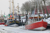 Boats in icy waters