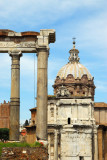 Columns of the Temple of Saturn with the dome of Santi Luca e Martina