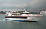 Batam Fast Ferry Asean Raider I pulling in to dock at the base of the Sentosa Bridge