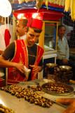 Boy in a Turkish costume preparing snacks