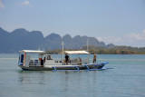 SeaDive's large boat with Coron Island in the distance