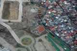 New construction walled off from a shanty town, suburban Manila (N14.477/E120.993)