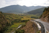 Leaving the rice fields of Lobesa behind driving on the road north to Punakha