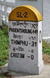 Road marker at Chuzom, 31km to Thimphu and 141 to the Indian border