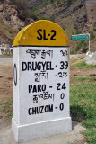 Road marker at Chuzom on the road to Paro and Drugyel