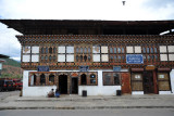Downtown Paro - Vajarayana Art Gallery along with a traditional boot shop and a Tashi Wanmo Handicrafts