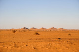 Six small hills rising out of an otherwise flat desert