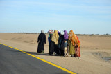 A group of women walking along the road
