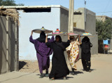 Sudanese women carrying trays of food, Kerma