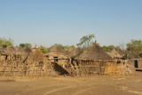 Village of thatched rondavels west of Al Gedarif, Eastern Sudan