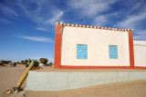 Tidy Nubian house with stripes painted along the roofline