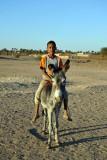 Nubian boy on a donkey, Soleb