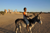 Nubian boy on a donkey in front of the Temple of Soleb