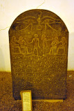 Black granite stela carved with hieroglyphics
