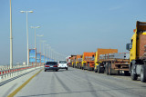 Trucks backed up for miles along the King Fahd Causeway approaching the border checkpoint