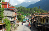 Observing a Nepali town from the top of a public bus
