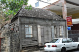 An old abandoned and weather-beaten wooden cabin left over from the early days of Port Louis
