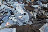 Piles of jeans of a street vendor, Port Louis