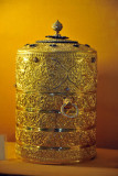 Gold Tiffin box with trays carved with flora and fauna