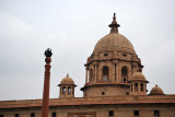 Two identical domed buildings housing the Ministries face each other across the Rajpath