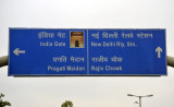 Road sign for the India Gate and New Delhi Railway Station