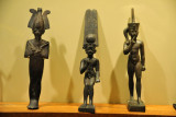 Osiris with two statuettes of Horus as a child