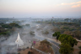 Early morning smoke from a fire as we float over the Bagan-Nyang U Road