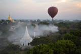 Balloon passing over a smoking fire, Bagan