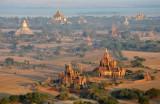 Shwesandaw Phaya (sunset temple) and Thatbyinnyu Phaya (tallest temple), upper left